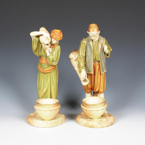A pair of Royal Worcester figures of Eastern Water Carriers, Dated 1898