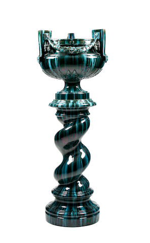 A Jerome Massier green glazed jardinière and stand