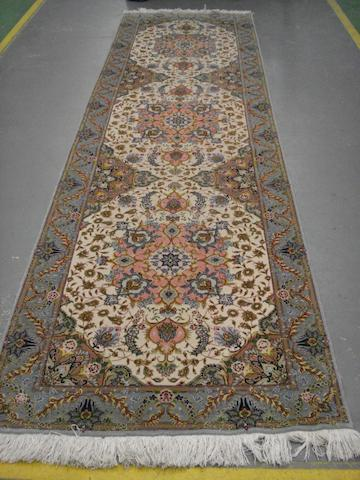 A Tabriz runner North West Persia, 311cm x 89cm
