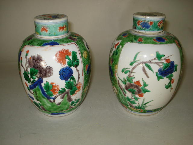 A pair of Chinese famille verte oviform jars and covers. .