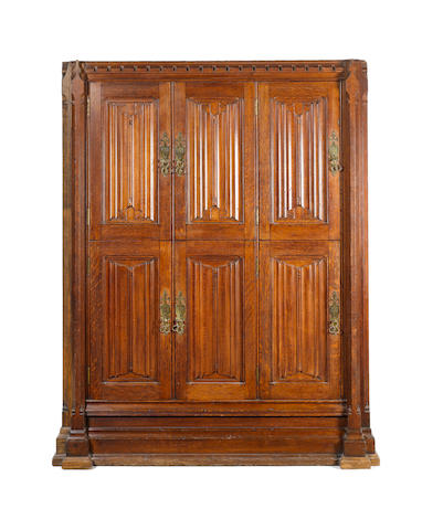 An impressive Gothic Revival oak locker cupboard attributed to A W N Pugin for Crace & Co.