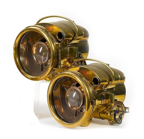 A pair of BRC Alpha 110 self-generating acetylene headlamps,