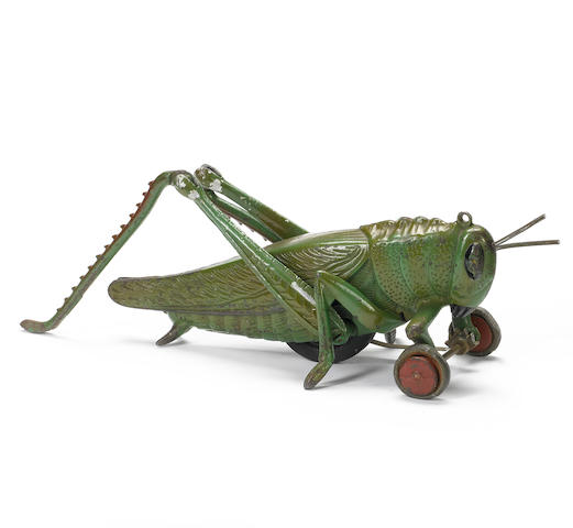 Hubley cast iron pull along grasshopper toy, American, circa 1925,