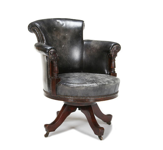 An early 20th century mahogany and leather upholstered desk chair