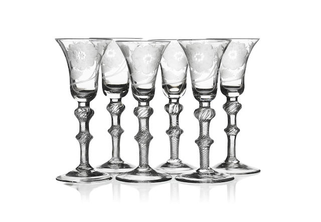A set of six engraved Jacobite airtwist wine glasses 18th century