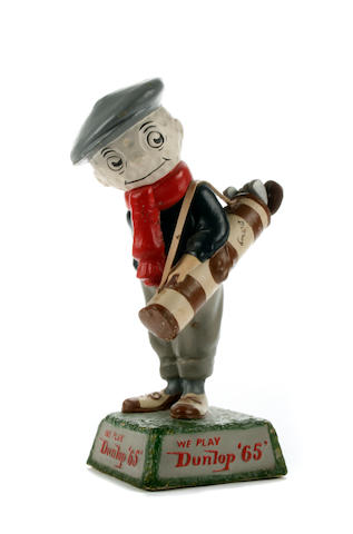A very rare small Dunlop 65 Caddie point of sale figurine