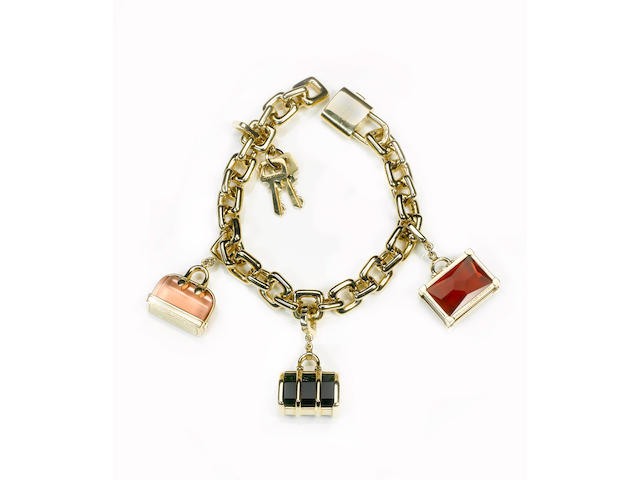 Louis Vuitton - a fine ladies 18 ct gold charm bracelet,