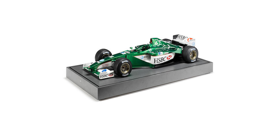 A Jaguar R4 Formula 1 car display model,