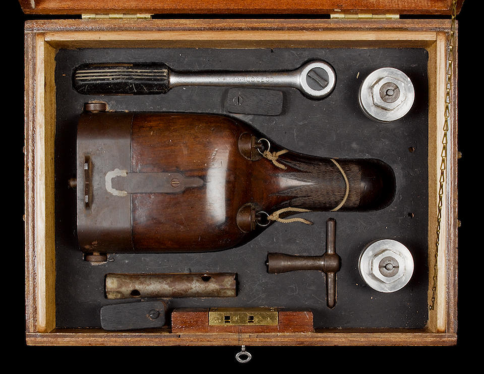 A 1¼-bore double-barrelled punt gun by Townsend And Owens The false-breech and screw-plugs contained within a fitted timber box, along with a wrench and striker-disc keys for the screw-plugs and hammers, the lid with a brass plaque engraved Townsend & Owens, Braintree, Anno 1981