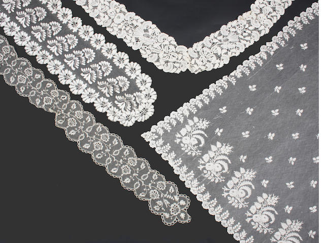 A large square Brussels bobbin lace bonnet veil on droschel ground