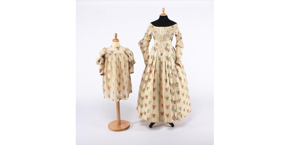 A lady's mid 19th century floral dress, with a matching childs dress