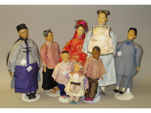 Eight carved wooden Door of Hope Mission dolls 8
