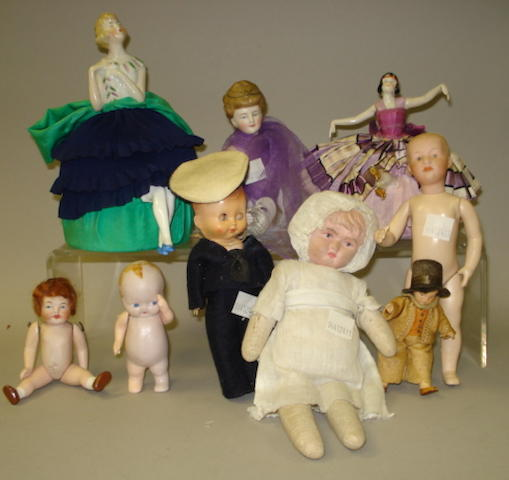 Collection of various small dolls, including half dolls lot