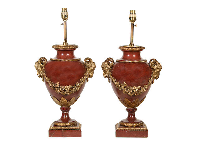 A pair of Louis XVI style rouge marble and gilt bronze urnsmounted as table lamps