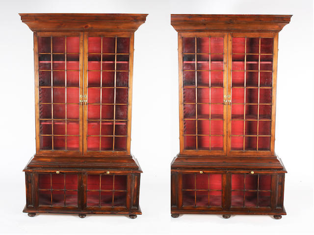 A pair of Pepys type stained pine and glazed door bookcases, early/mid 20th century
