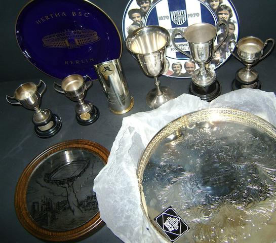A collection of trophies and ceramic plates