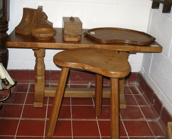 "Robert ""Mouseman"" Thompson of Killun: A rectangular coffee table,on octagonal section end supports, 93cm long, a three-legged stool, a kidney-shaped tray, a pair of book ends, a rectangular box with lift-off lid, a sweetmeat dish and an ashtray. (8)"
