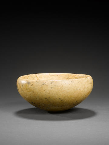 An Egyptian mottled cream stone bowl