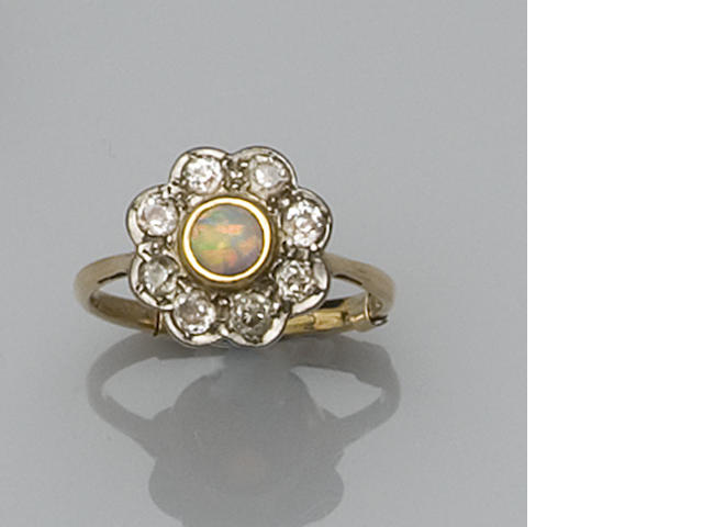 An early 20th century opal and diamond cluster ring