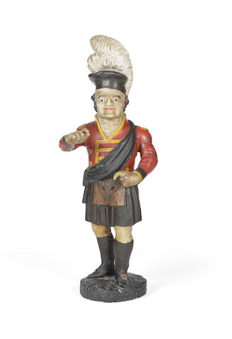 A carved wood and painted gesso tobacco advertising figure
