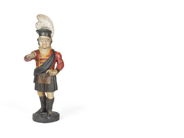 A mid 18th century carved wood and painted gesso tobacco advertising figure