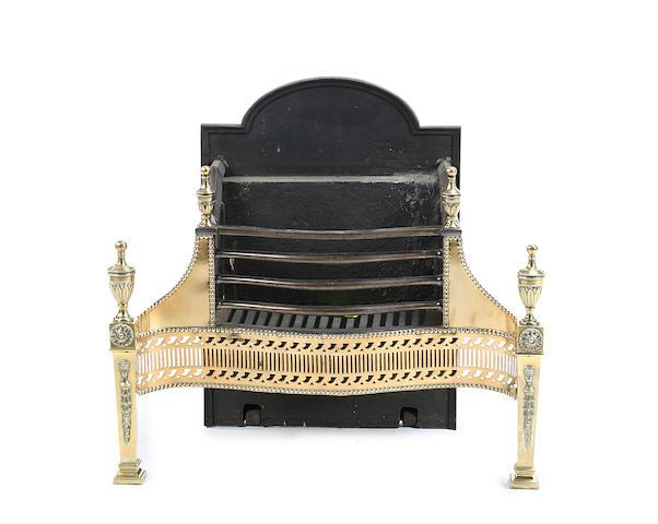An early 20th century Adam style brass firegrate