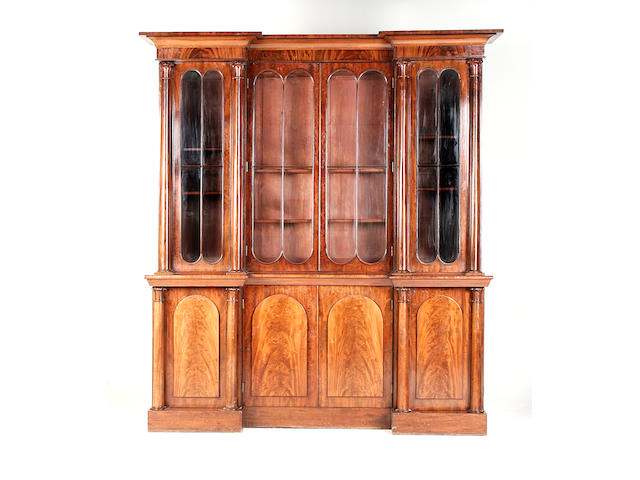 An early Victorian inverted breakfront mahogany library bookcase