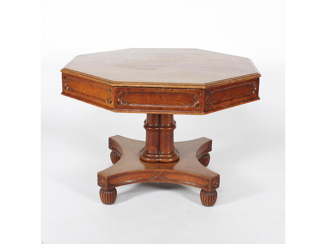 An early Victorian Gothic design oak drum library table