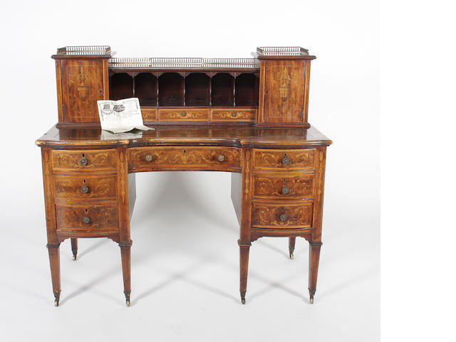 A late 19th century mahogany and inlaid  kneehole desk.
