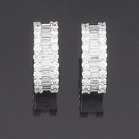 A pair of diamond half-hoop earrings