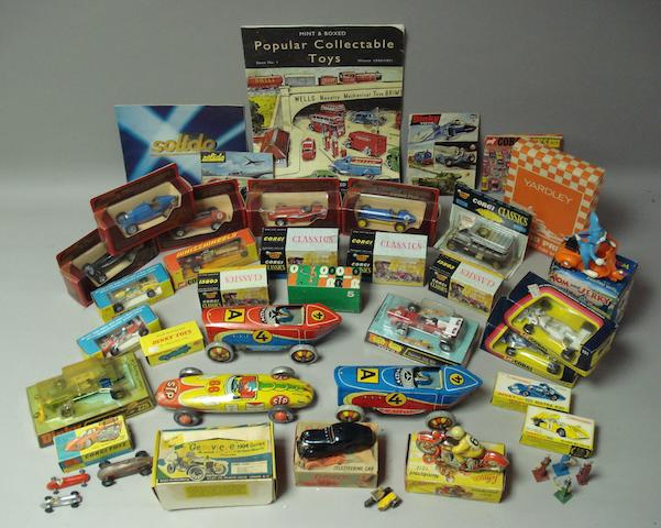 A collection of assorted tin-plate and die-cast toy cars,