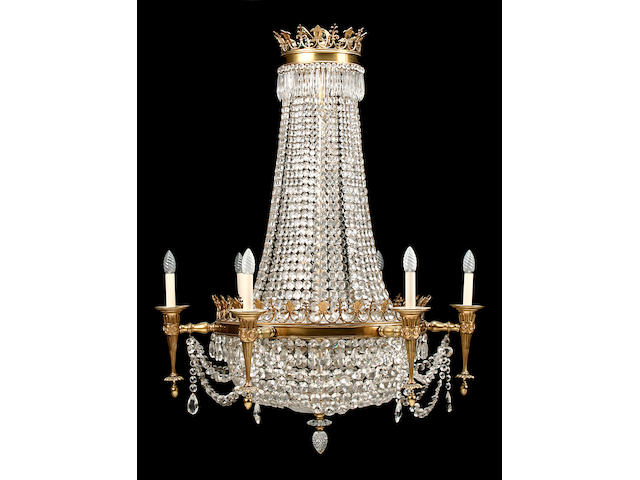 A large Empire style ormolu and cut glass tent and bag chandelier