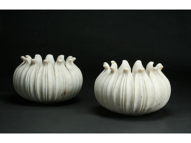 A pair of Mughal style carved white marble jardinières