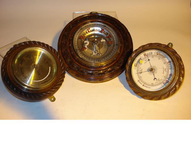 Three early 20th century carved wood aneroid barometers  Unsigned  3