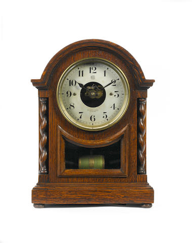 An early 20th century Bulle patent electrical mantel timepiece Salsbury & Sons, Guildford