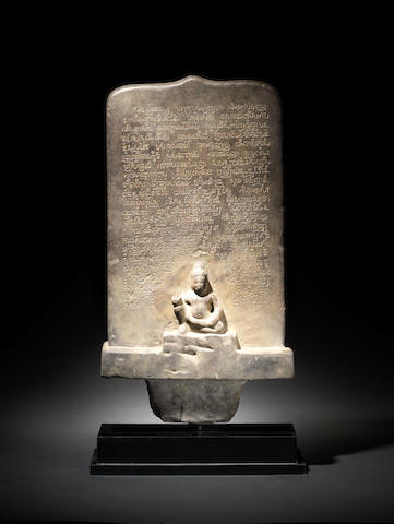 A rare Khmer sandstone inscribed stele with figure of Buddha, Baphuon period, 11th century