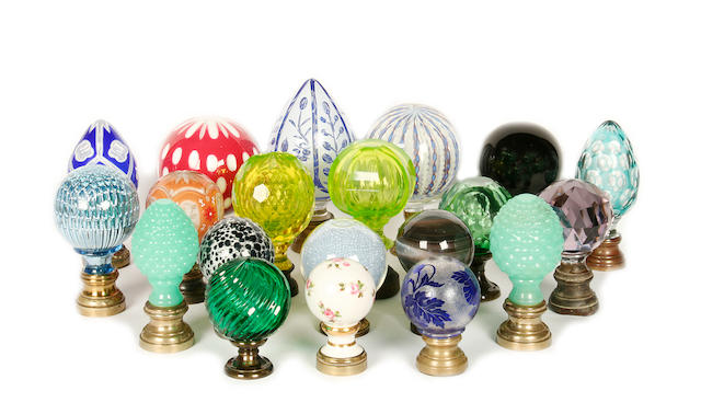 A collection of porcelain, opaque glass and clear glass newel post finials