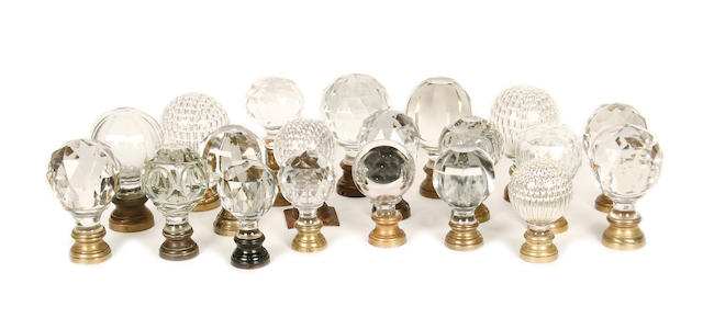 A collection clear and opaque glass newel post finials