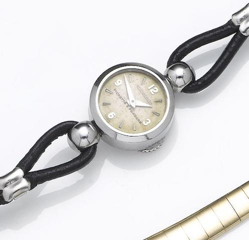 Jaeger LeCoultre. A lady's stainless steel back-winding wristwatch retailed by Picketts & Pursers1950's
