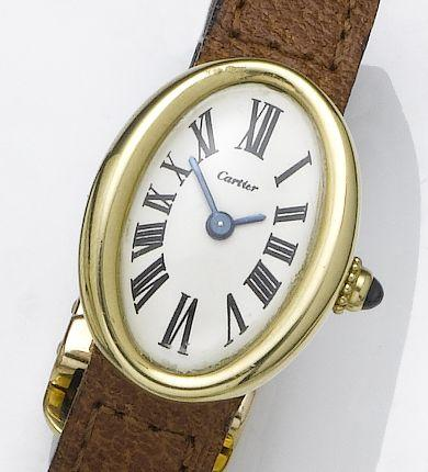 Cartier. A lady's 18ct gold wristwatch Baignoire, London Import mark for 1975