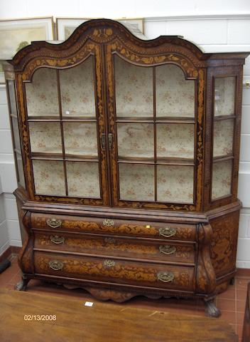 An 18th Century style Dutch floral marquetry bombe display cabinet