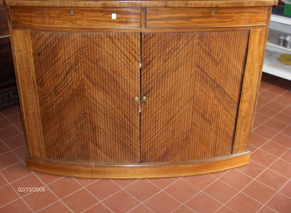 A pair of Regency style bow front cabinets,
