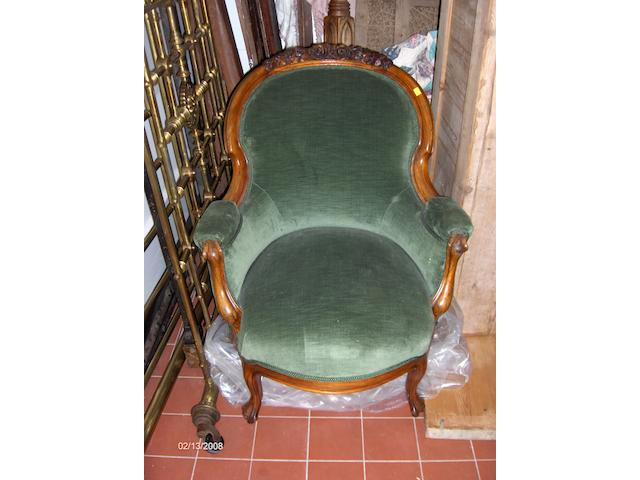 A Victorian style walnut three piece drawing room suite covered in green plush and on cabriole legs, comprising two seater settee and two armchairs.
