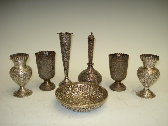 A collection of Indian and Burmese white metal wares