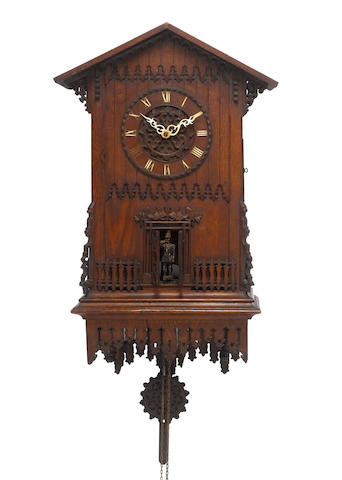 A third quarter of the 19th century Black Forest carved oak trumpeter clock  Signed to the bellows,