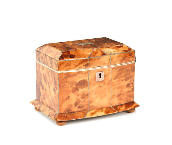 A small blond tortoiseshell and ivory strung bowfront tea caddy