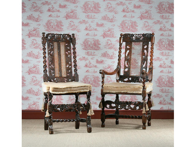 A harlequin set of 12 carved walnut and caned dining chairs.Third quarter of the 17th century