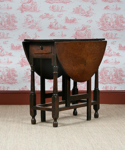 An oak occasional gateleg table, circa 1700