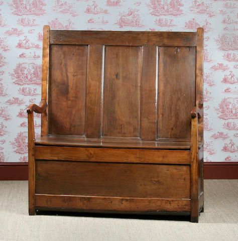 A mid 18th Century oak box settle