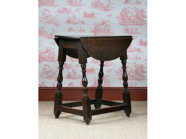 A mid 17th Century oak stool table, circa 1650